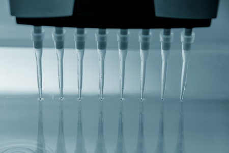 genetic: Multi pipette in genetic laboratory Stock Photo
