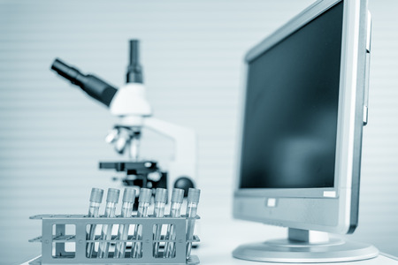 biopsy: Modern microscope station with tissue section on the screen Stock Photo