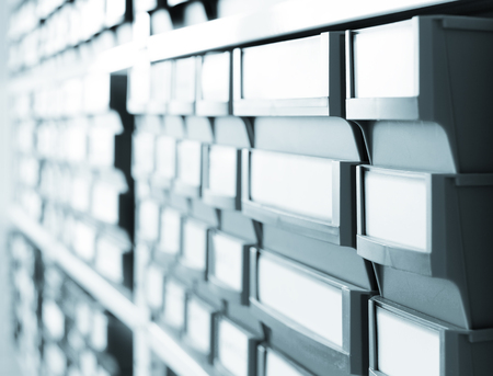 shelving: Shelving with plastic boxes Stock Photo