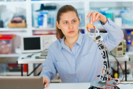robot woman: cientist develops Software for the robot arm Stock Photo