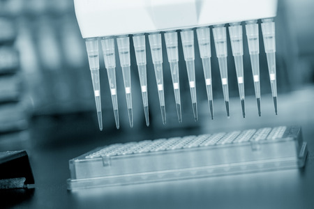 sequencing: Multi pipette in genetic laboratory Stock Photo