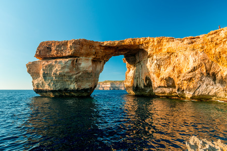 Azure Window, famous stone arch on Gozo island with reflection, Malta Stock Photo