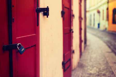 saluzzo: Red wooden door with lock