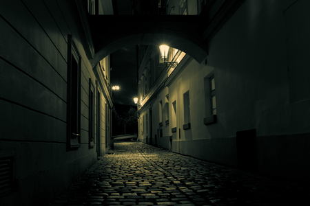 empty street: mysterious alley with lanterns in Prague at night Stock Photo
