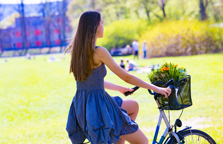 carefree: Young woman with retro bicycle in a park - outdoor portrait