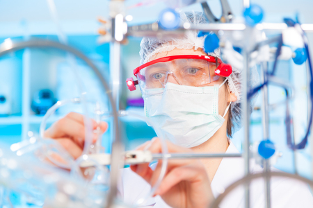 pharmaceutical factory woman worker operating production