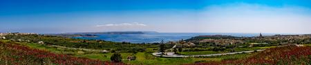 panoramic view: Panorama view of Mgarr city with green field. Gozo, Malta Stock Photo