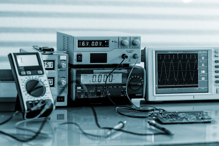 machine tool: Development of electronic devices in the modern electronics laboratory, on a table, microprocessor oscilloscope and multimeter