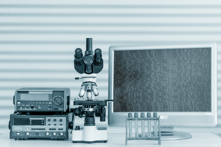 cns: Modern microscope equipped with digital camera, computer and monitor Stock Photo