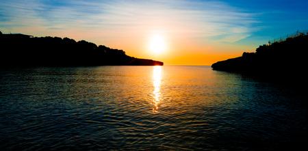 Cliffs  at sunset. Sunrise in sea