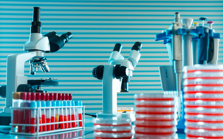 scientifically: Laboratory work place with microscope, test tube and pipettes.