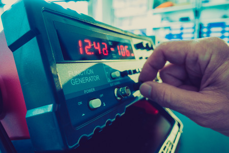 signals: Ajust the function generator, electronic measuring instruments Stock Photo