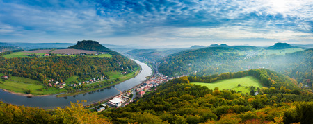 View from viewpoint of Bastei in Saxon Switzerland Germany to the town city and the river Elbe  in autumn. Low of sharpness because haze 免版税图像