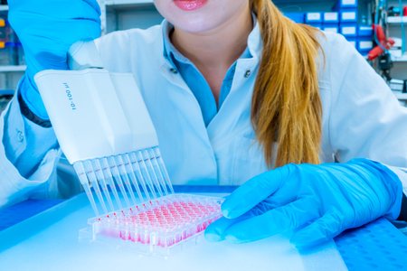 scientist woman in genetic laboratory