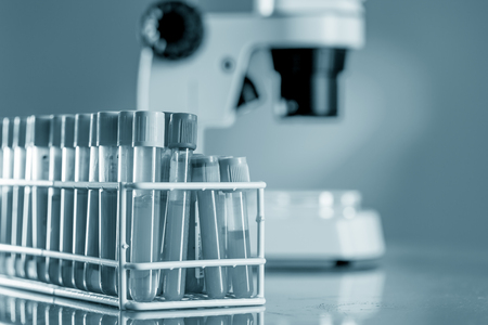 clinical: Workbench blood bank laboratory with a microscope and tubes with patient samples