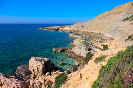 sawgrass: rough and rocky coastline of the island of malta , europe Stock Photo