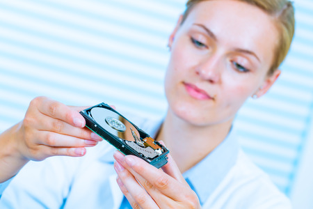 hdd: girl student with a hard disk HDD in the hands Stock Photo