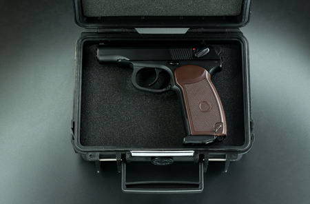 criminal case: gun in the suitcase Stock Photo