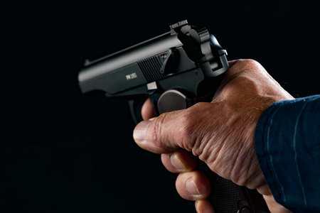 hand gun: PM makarov Gun in man hand on black background
