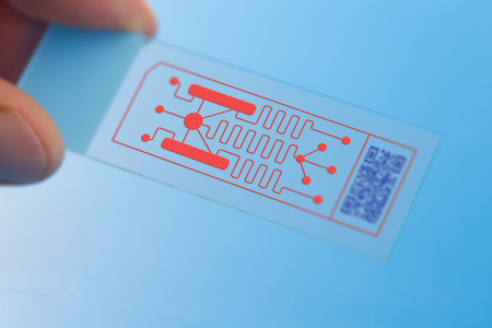 Lab on chip (LOC) is device that integrates laboratory functions on nano chip Stock Photo