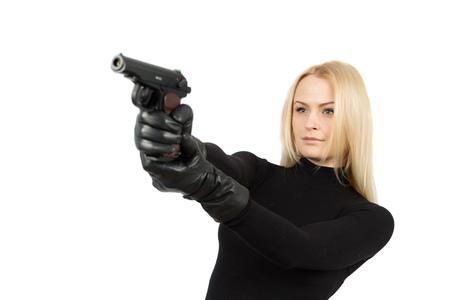 Vrouwelijke geheime dienst agent in zonnebril met pistool Stockfoto - 52565293