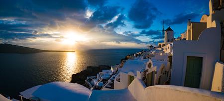 Beautiful sunset panorama in Oia village, Santorini, Greece