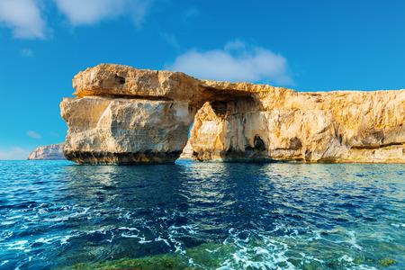 azure: Azure Window, famous stone arch of Gozo island in the sun in the winter Malta