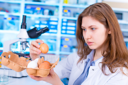 food inspection: woman  technician in food quality control laboratory Stock Photo