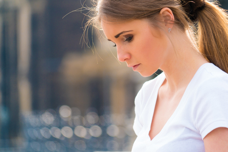 sad lady: Outdoor Portrait young beautiful  woman, look down Stock Photo