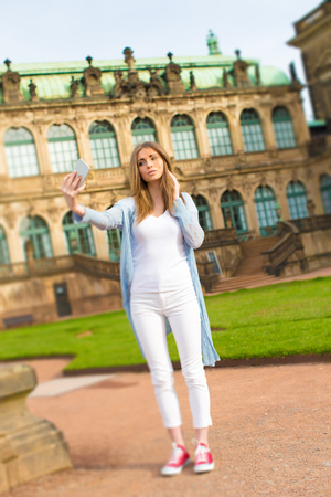 beautiful teen: Woman tourist photographs the historic city center of Dresden, Germany