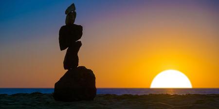 rocks water: Stone piramide. Sea sunset