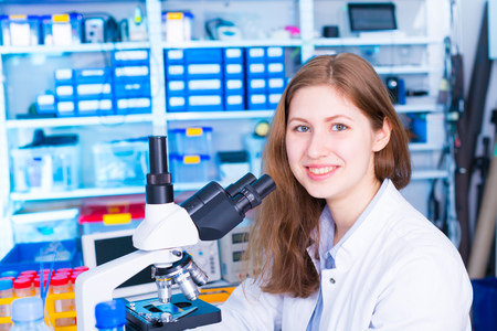 microscope: woman  technician in laboratory Stock Photo