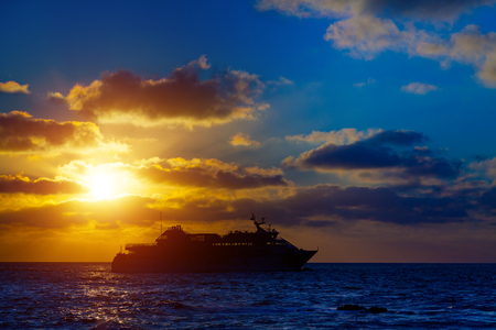 liner: Cruise ocean liner at sunset Stock Photo