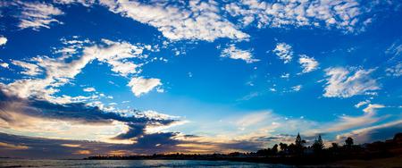 sunset sky: Sunset sky on coastline Stock Photo
