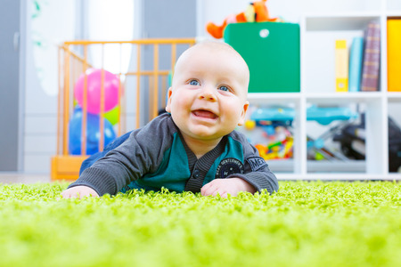 one child: Baby on the grass carpet