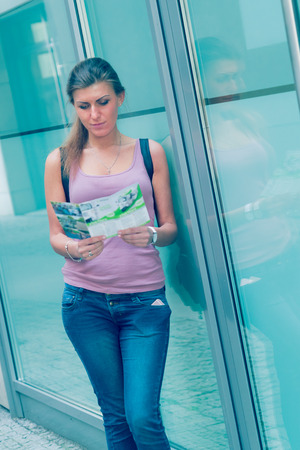 guid: Young woman read travel guid