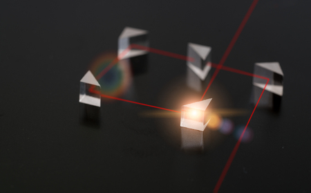 laser beam: The laser beam in the experiment with quartz prisms Stock Photo