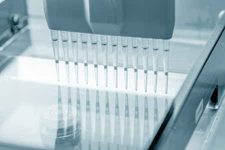 electrophoresis: load DNA sample in electrophoresis device Stock Photo