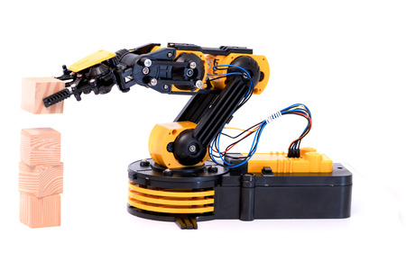 electronics industry: Plastic model of industrial robot arm Stock Photo