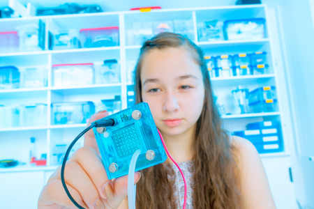 membrane: Student teen girl with experiment PEM proton exchange membrane reversible fuel-cell