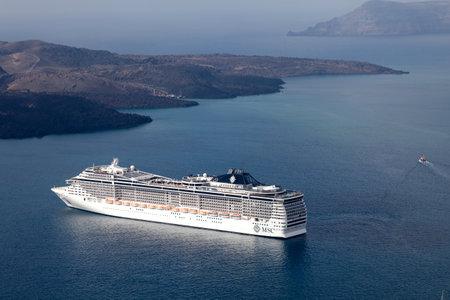 SANTORINI, GREECE-AUGUST 20: MSC Fantasia cruise ship near Santorini island in Aegean sea. MSC Fantasia is the largest cruise ship ever built for a European ship owner. It has 1637 staterooms.