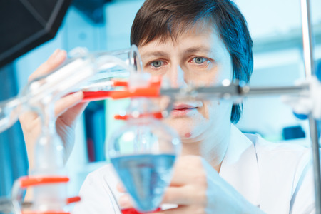 Woman in chemical laboratory photo