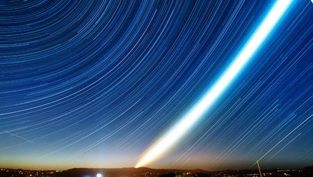 stars night: star trails on blue night sky