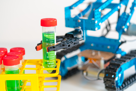 tracked: The robot arm tracks on doing an experiment with dangerous chemicals