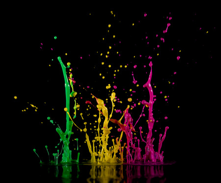 guar: Abstract sculptures of colorful splashes of paint. Dancing liquid on a black background. Ink water splash. Color explosion. Stock Photo