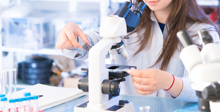science class: Student girl in microbiological class. Researsh in science laboratory Stock Photo