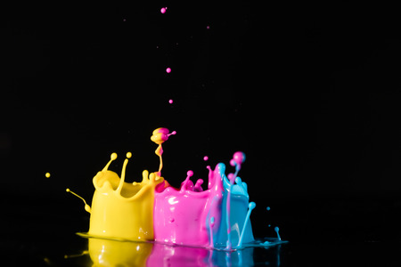 guar: ?bstract sculptures of colorful splashes of paint. Dancing liquid on a black background. Ink water splash. Color explosion. Stock Photo