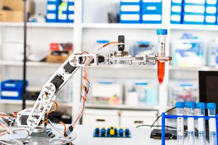 manipulator: Model of industrial robot manipulator, robot arm with test tube