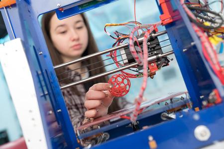 fused: Young woman, schoolgirl print 3D model on 3D printer