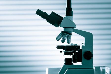 lab tech: microscope